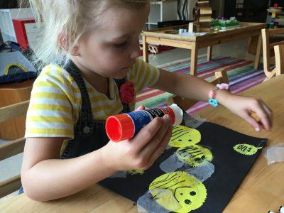VCS preschool girl gluing